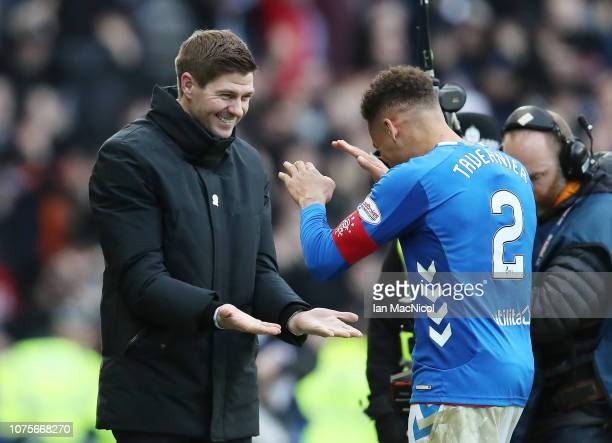 Rangers manager Steven Gerrard reacts with James Tavernier of Rangers during the Ladbrookes Scottish Premiership match between Rangers and Celtic at...