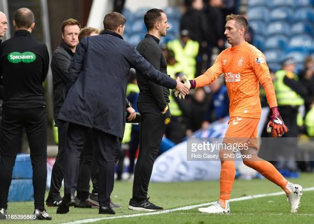 Rangers manager Steven Gerrard with Allan McGregor during the Ladbrokes Premier match between Rangers and Celtic at Ibrox Stadium, on September 1 in...