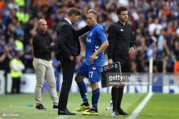 Rangers manager Steven Gerrard with Scott Arfield after being substituted during the Europa League Qualifying Round One First Leg match at Ibrox...