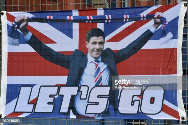 Rangers merchandise bearing the name and face of Ranger new manager Steven Gerrard on display outside Ibrox Stadium during the PreSeason Friendly...