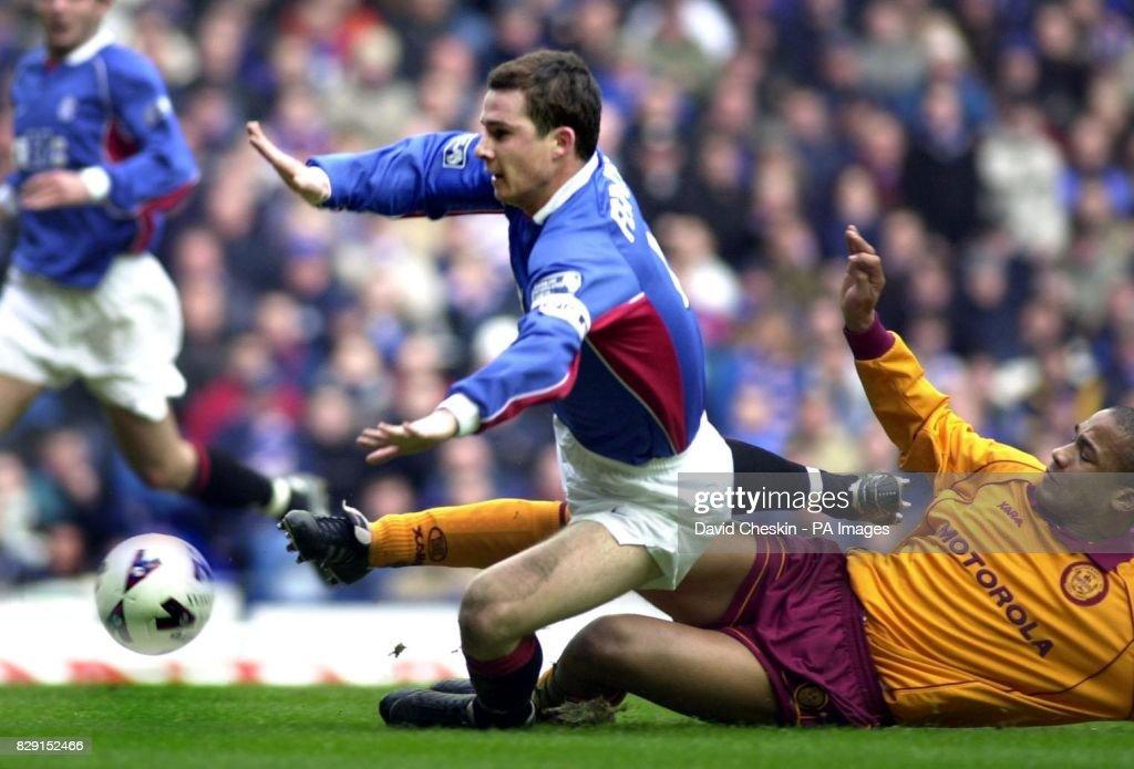 Rangers midfielder Barry Ferguson holds off Motherwell's