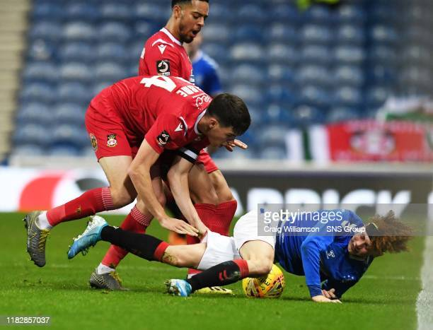 Rangers Nathan YoungCoombes is fouled by Douglas Tharme during the Tunnock's Caramel Wafer Cup Quarter Final match between Rangers Colts and Wrexham...