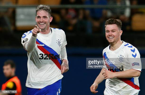 Rangers' Northern Irish forward Kyle Lafferty celebrates after scoring a goal with Rangers' Scottish midfielder Glenn Middleton during the UEFA...