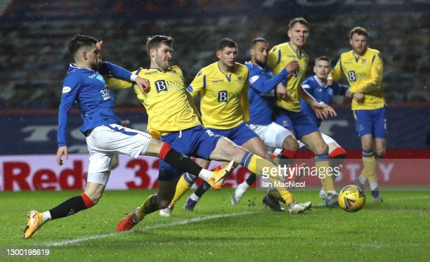 Rangers player Ianis Hagi gets in an attempt on goal despite the attentions of St Johnstone defender Jamie McCart during the Ladbrokes Scottish...