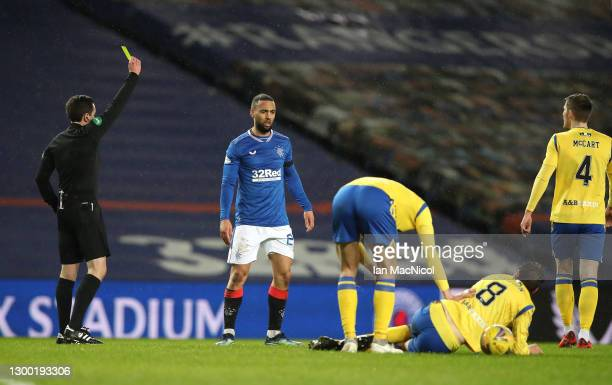 Rangers player Kemar Roofe is yellow carded by referee David Munro after a challenge on Murray Davidson of St Johnstone during the Ladbrokes Scottish...