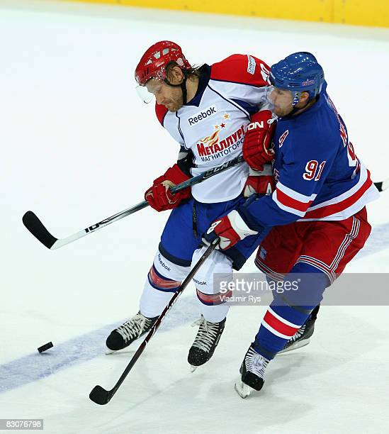 Rangers player Markus Naslund and Alexander Seluyanov of Metallurg battle for the puck during the Victoria Cup game between Metallurg Magnitogorsk...