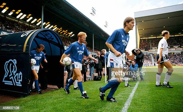 Rangers player Mo Johnston makes his way onto the pitch behind Richard Gough for his debut in a pre season friendly against Tottenham Hotspur at...