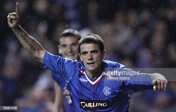 Ranger's player Nacho Novo from Spain celebrates scoring a goal during a Champions League third round qualifier at the Ibrox Stadium in Glasgow...