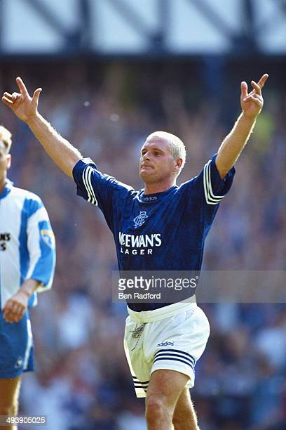 Rangers player Paul Gascoigne celebrates a goal during the Scottish Premiership match between Rangers and Raith Rovers at Ibrox on August 20, 1995 in...