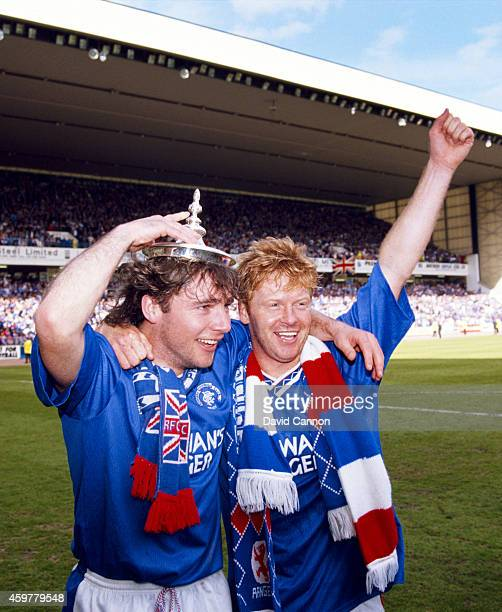 Rangers players Ally McCoist and Maurice Johnston celebrate after Rangers had beaten Aberdeen in the title decider 20 to claim the 1990/91 Scottish...