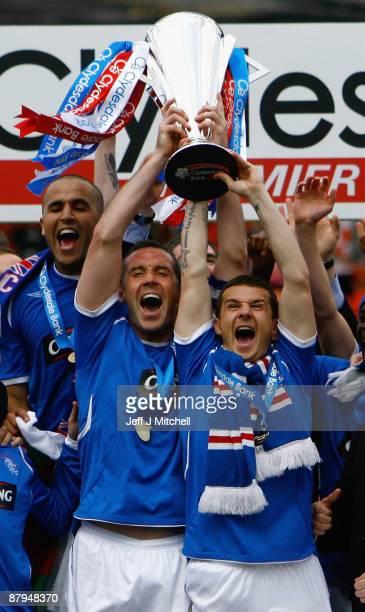 Rangers players Barry Ferguson and David Weir celebrate winning the Scottish Premier League trophy after the Scottish Premier League match between...