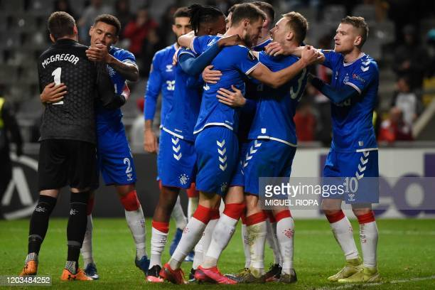 Rangers' players celebrate at the end of the UEFA Europa League round of 32 second leg football match between SC Braga and Rangers at the Municipal...