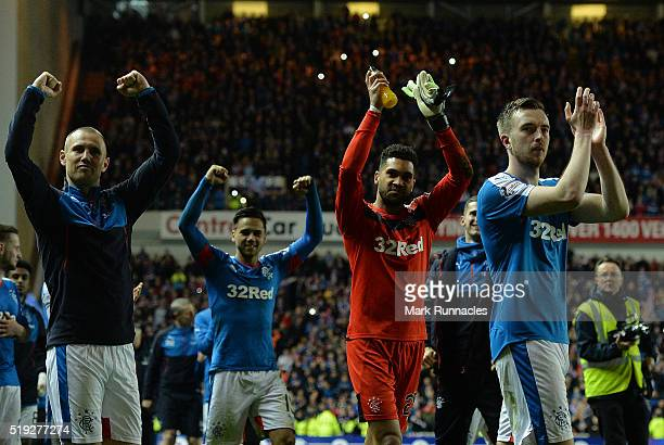Rangers players celebrate on the pitch as Rangers beat Dumbarton 10 to clinch the Scottish Championship title during the match between Glasgow...