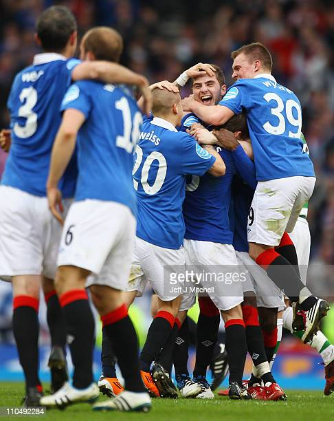 Rangers players celebrate wining the Cooperative Insurance Cup after beating Celtic 21 in the final at Hampden Park on March 20 2011 in Glasgow...
