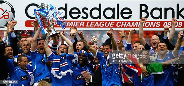 Rangers players celebrate winning the Scottish Premier League trophy after the Scottish Premier League match between Dundee United and Rangers at...