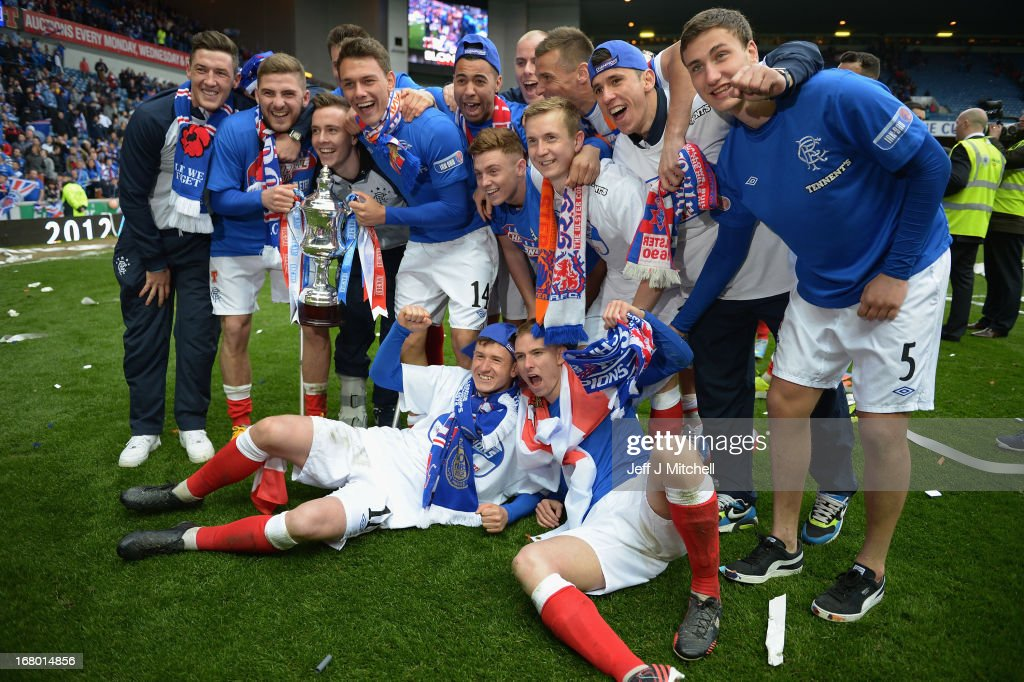 Rangers players celebrate with the IRN - BRU Scottish Third Division trophy following their victory over Berwick Rangers at Ibrox Stadium on May 4, 2013 in Glasgow, Scotland.