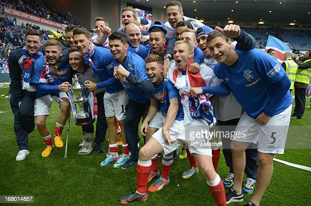Rangers players celebrate with the IRN - BRU Scottish Third Division trophy following their victory over Berwick Rangers at Ibrox Stadium.