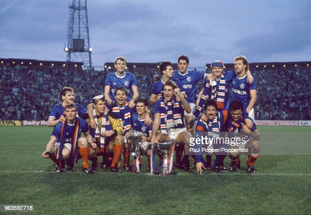 Rangers players celebrate with the trophy after the Skol Cup Final between Rangers and Celtic at Hampden Park on October 26, 1986 in Glasgow,...