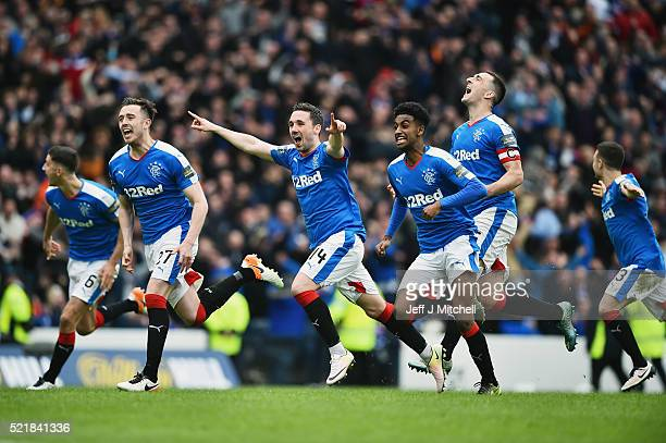 Rangers players celebtate after beating Celtic in a penalty shoot out during the William Hill Scottish Cup semi final between Rangers and Celtic at...