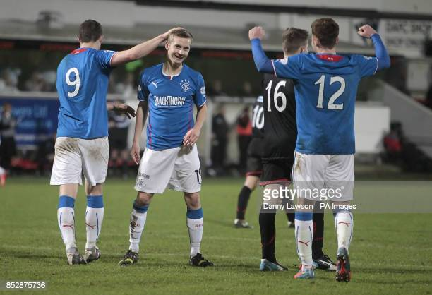 Rangers' Robbie Crawford celebrates his goal with team mates Jon Daly and Lewis MacLeod during the Scottish League One match at East End Park...
