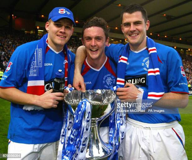 Rangers' Robert Malcolm Maurice Ross and Steven Thompson celebrate with the CIS Insurance Cup