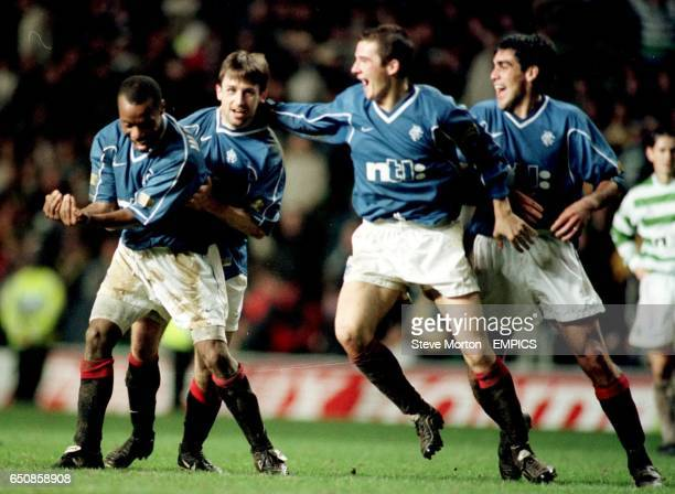 Rangers' Rod Wallace celebrates with teammates Neil McCann Barry Ferguson and Claudio Reyna after scoring the winning goal