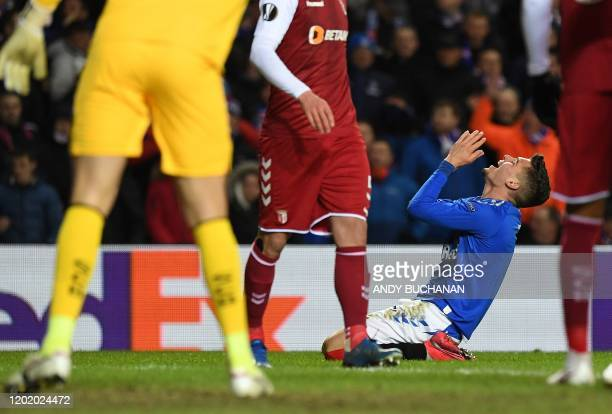 Rangers' Romanian midfielder Ianis Hagi reacts after unsuccessfully claiming for a penalty after clashing with Sporting Braga's Brazilian goalkeeper...