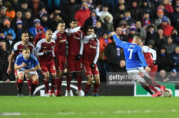 Rangers' Romanian midfielder Ianis Hagi scores his team's third goal from a freekick during the UEFA Europa League round of 32 first leg football...