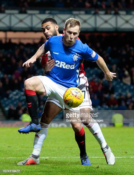 Rangers' Scott Arfield vies with Hamilton Academical's Alex Penny during the Ladbrokes Scottish Premiership match at Ibrox Stadium Glasgow