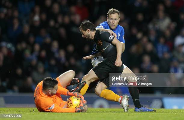 Rangers' Scott Arfield vies with Livingston's Liam Kelly and Keaghan Jacobs during the Ladbrokes Scottish Premiership match at Ibrox Stadium Glasgow