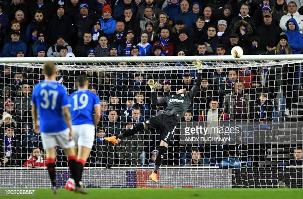 Rangers' Scottish goalkeeper Allan McGregor dives but fails to save the opening goal by Sporting Braga's Brazilian midfielder Fransergio during the...