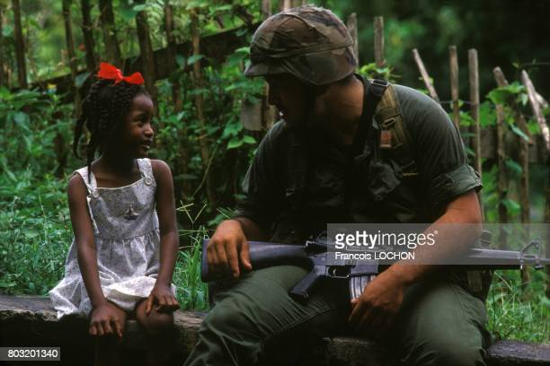 US Rangers Soldier With A Little Girl After The Invasion Of Grenada By The United States And The Organisation Of Eastern Caribbean States in October...