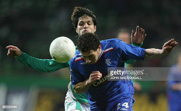 Rangers' Spanish defender Carlos Cuellar intercepts Werder Bremen's Brazilian midfielder Diego during the Werder Bremen vs Rangers FC round of 16...