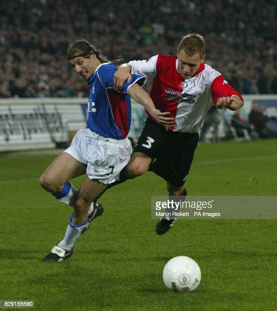 Rangers striker Claudio Caniggia battles with Feyenoord 's Tomasz Rzasa during their Uefa Cup Fourth Round second leg match at Feyenoord's Kuip...