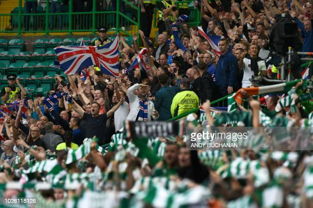 Rangers supporters and Celtic supporters prepare for the Scottish Premiership football match between Celtic and Rangers at Celtic Park stadium in...
