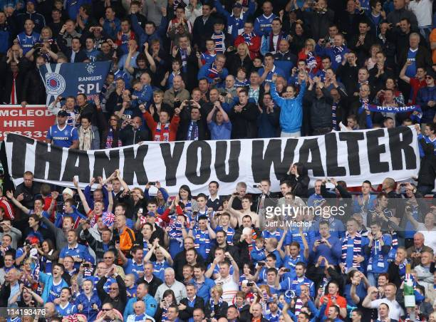 Rangers supporters celebrate after winning the Clydesdale Bank Premier League at Rugby Park on May 15 2011 in Kilmarnock Scotland