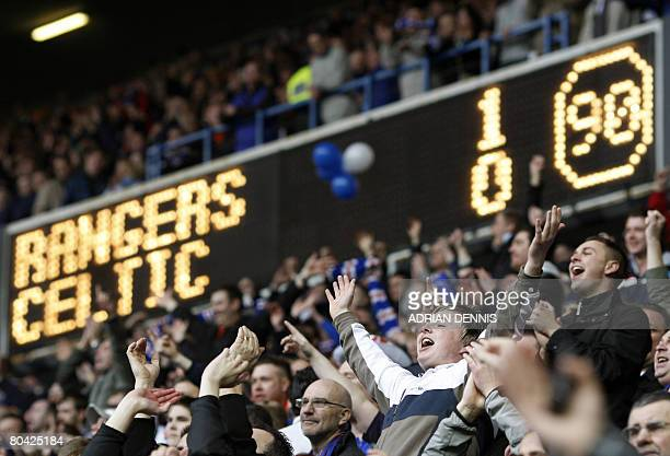 Rangers supporters gesture to Celtic fans after the final whistle during the Scottish Premier League football match at Ibrox Stadium in Glasgow March...