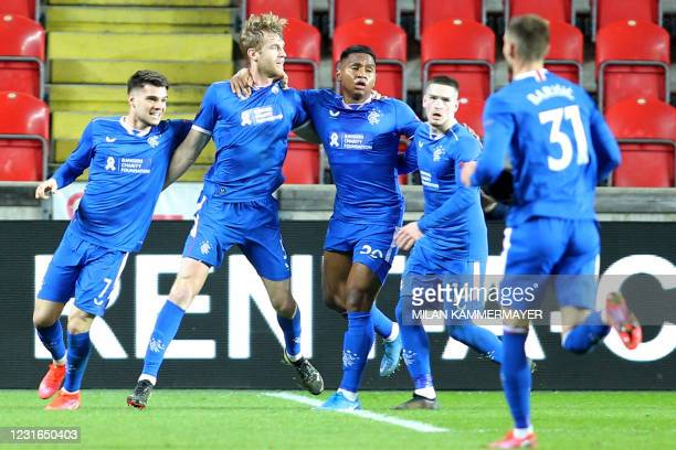 Rangers' Swedish defender Filip Helander celebrates scoring with his team-mates during the UEFA Europa League, last 16, first Leg football match...