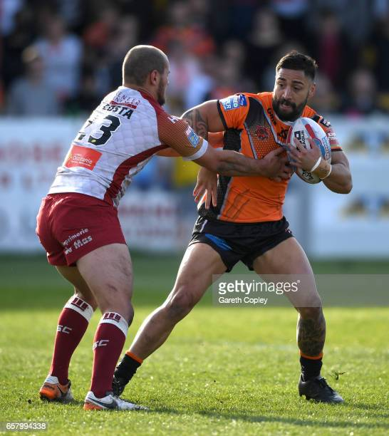 Rangi Chase of Castleford is tackled by Alrix Da Costa of Catalans during the Betfred Super League match between Castleford Tigers and Catalans...