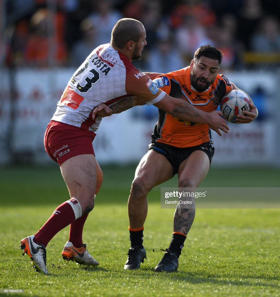 Rangi Chase of Castleford is tackled by Alrix Da Costa of Catalans during the Betfred Super League match between Castleford Tigers and Catalans Dragons at Wheldon Road on March 26, 2017 in Castleford, England.