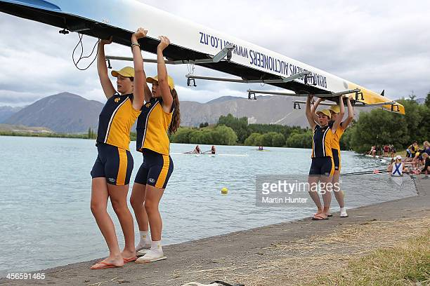 Rangi Ruru Girls launch their boat during the 2013 Meridian Otago Championships at Lake Ruataniwha on December 15, 2013 in Central Otago, New Zealand.