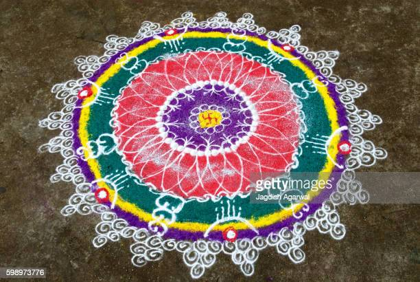Rangoli floor design with swastik during diwali deepawali festival