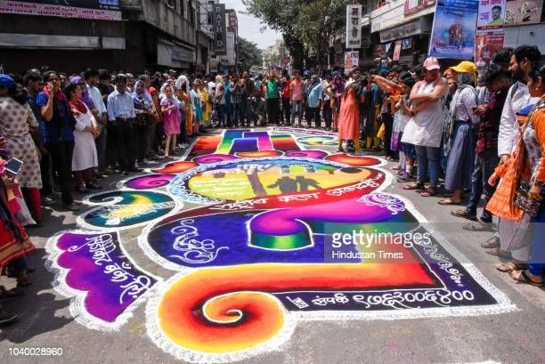 Rangoli for welcoming the Ganesha procession on Laxmi Road on the last day of Ganesh Chaturthi festival, on September 23, 2018 in Pune, India. The...
