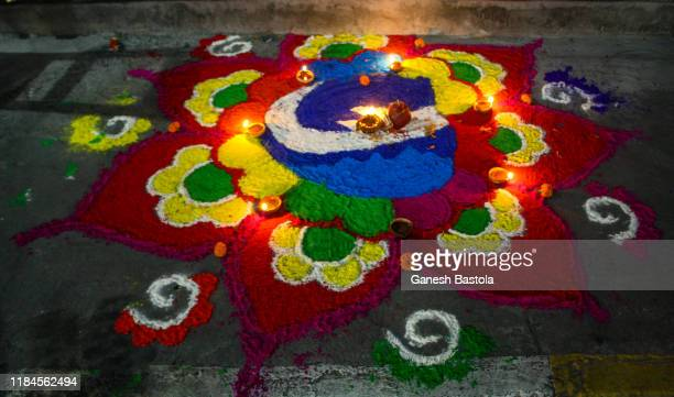 rangoli: top view. celebration of laxmi puja on diwali. - laxmi ganesh stock pictures, royalty-free photos & images