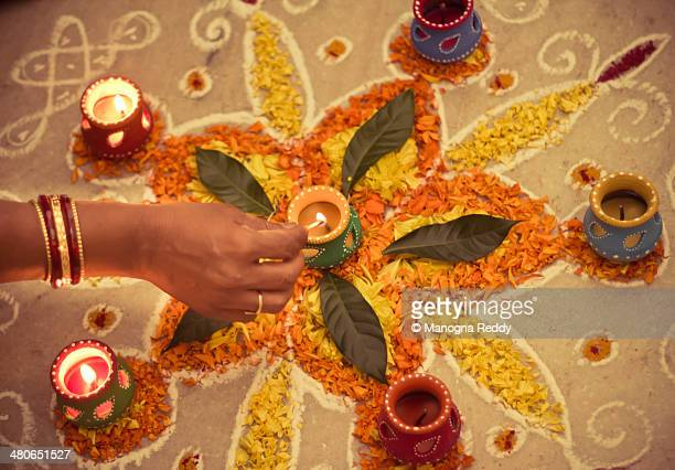 rangoli with diyas - rangoli stock pictures, royalty-free photos & images