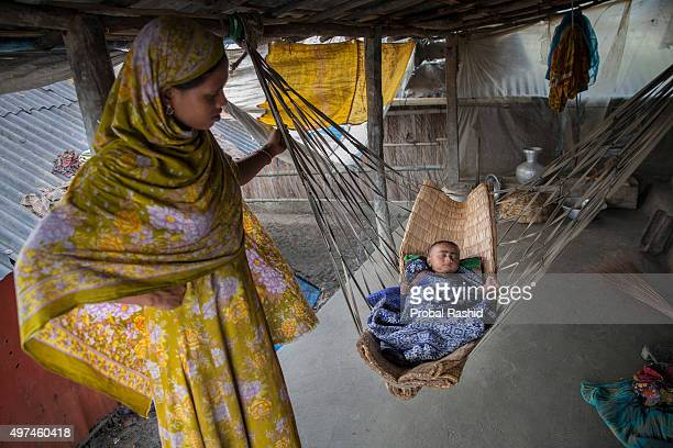 SHYAMNAGAR SATKHIRA KHULNA BANGLADESH Rani Begum was married at the age of 12 She stands beside her child in Shyamnagar on 28 August 2015 The...