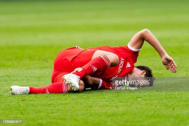 Rani Khedira of 1. FC Union Berlin injured on the ground during the Bundesliga match between 1. FC Union Berlin and VfL Wolfsburg at Stadion An der...