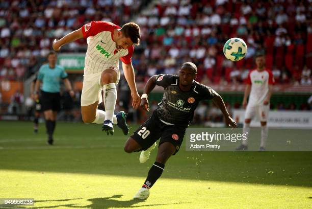 Rani Khedira of Augsburg and Anthony Ujah of Mainz head for the ball during the Bundesliga match between FC Augsburg and 1 FSV Mainz 05 at WWKArena...