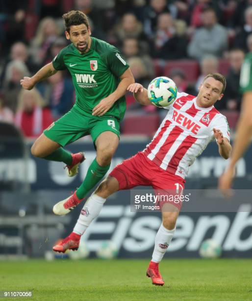 Rani Khedira of Augsburg and Christian Clemens of Koeln battle for the ball during the Bundesliga match between 1 FC Koeln and FC Augsburg at...