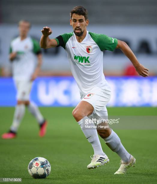 Rani Khedira of Augsburg controls the ball during the Bundesliga match between FC Augsburg and SC Paderborn 07 at WWKArena on May 27 2020 in Augsburg...